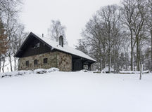 Cottage in winter ambiance Royalty Free Stock Image
