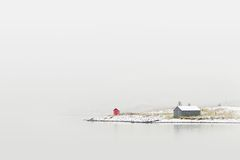 Cottage on winter coast Stock Photo