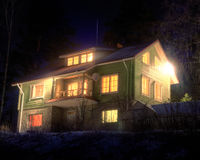 Cottage at winter night Royalty Free Stock Photography