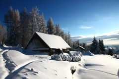 Cottage in winter Stock Photos
