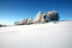 Cottage in winter Stock Photography