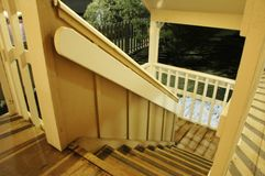 Cottage Wooden Stairs. Stairs leading down from a wooden house royalty free stock photography
