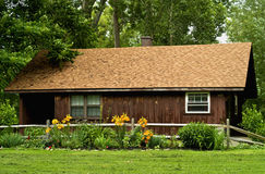 Cottage in woods. Cottage in a forest in spring Royalty Free Stock Photo