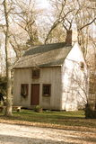 Cottage in the Woods. A small country cottage sits alone in the woods Stock Photography