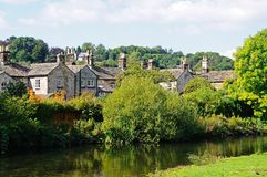Cottages alongside river, Bakewell. Royalty Free Stock Photo