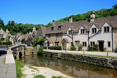 Cottages alongside the river, Castle Comble. Stone cottages alongside the river Bybrook, Castle Combe, Wiltshire, England, UK, Western Europe stock photography