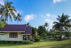 Cottages on the Bay in a tropical garden Stock Photography