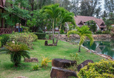 Cottages on the Bay in a tropical garden Stock Photo