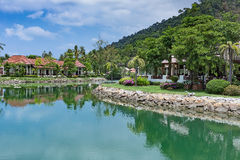 Cottages on the Bay in a tropical garden Royalty Free Stock Images