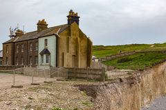 Cottages at Beachy Head,. These were the cottages built for coastguards in the early 1800s and due to erosion some of them have been demolished royalty free stock image