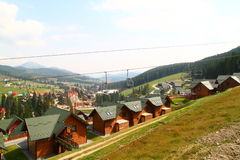 Cottages in Carpathian Mountains. Cottages, chair lift in Carpathian Mountains Stock Photography