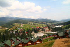 Cottages in Carpathian Mountains. Cottages, chair lift in Carpathian Mountains Stock Photos