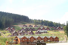 Cottages in Carpathian Mountains. Cottages, chair lift in Carpathian Mountains Stock Images