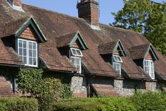 Cottages de brique chez Wherwell hampshire l'angleterre Images stock