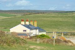 Cottages de garde-c?te Bas du sud, Cuckmere, le Sussex photographie stock