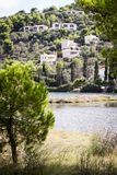 Cottages at a hill in Skiathos stock photography