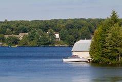 Cottages on Lake Muskoka. Cottages and a bothouse on Lake Muskoka, Ontario Royalty Free Stock Photography