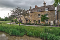 Cottages in Lower Slaughter, Cotswolds, UK. Cottages with Eye River in Lower Slaughter, Cotswolds, UK Royalty Free Stock Images