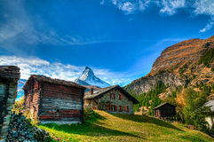Cottages and Matterhorn. Cottages, just outside of Zermatt, in front of the vast mountain, Matterhorn Stock Photos