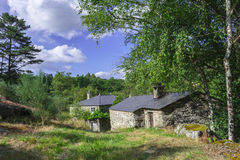 Cottages in the middle of nature Stock Images