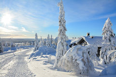 Cottages on snowy mountain on a sunny winter day Stock Photography