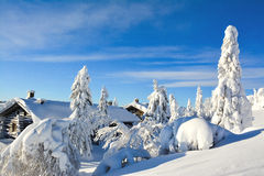 Cottages on snowy mountain on a sunny winter day Royalty Free Stock Photo