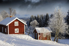 Cottages in snowy winter season Royalty Free Stock Photos
