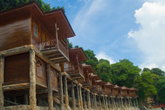 Cottages on stilits. Resort-style wooden cottages build on stilts on Batam Island, Indonesia Stock Photography