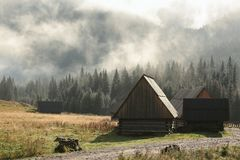 Cottages in the valley on a misty morning stock photo