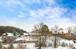 Cottages in the winter coniferous forest Royalty Free Stock Photo