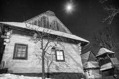Cottages at winter night Stock Images