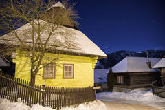 Cottages at winter night Royalty Free Stock Images