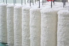 Cotton. Cotten rolls in a spinning factory Stock Photos