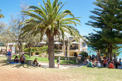 Cottesloe Beach Foreshore: Indiana Tea House. COTTESLOE,WA,AUSTRALIA-MARCH 12,2016: Treed foreshore of Cottesloe Beach with people relaxing and the Indiana Tea royalty free stock image