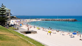 Cottesloe Beach Scene: Western Australia. Cottesloe Beach scene with stunning turquoise Indian Ocean waters,tourists and rocky groyne in Western Australia royalty free stock image