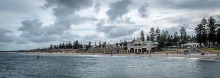 Cottesloe Beach Western Australia. Overcast day at surf beach with grey clouds and pine trees in scene Royalty Free Stock Photos