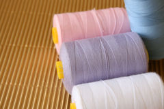 Cotton. In various colors of white, purple, pink and blue Royalty Free Stock Images
