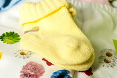 Cotton baby socks for newborn on a colorful pink background. Top view Royalty Free Stock Image