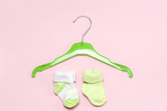 Cotton baby socks for newborn on a colorful pink background. Top view Stock Photography