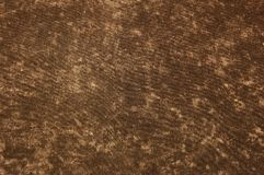 Cotton background. Brown grunge fabric cotton background with spots Stock Photo