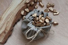 Cotton bag full of gold. Symbolizing richness and prosperity stock photography