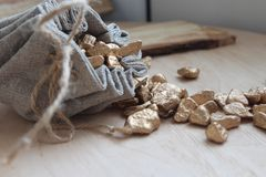 Cotton bag full of gold. Symbolizing richness and prosperity stock images