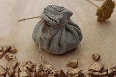 Cotton bag full of gold. Symbolizing richness and prosperity royalty free stock photos