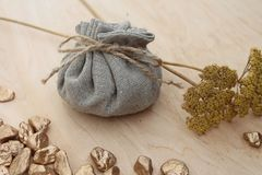 Cotton bag full of gold. Symbolizing richness and prosperity stock photo