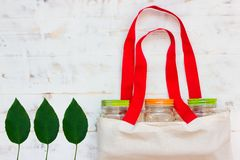 Cotton bags and glass gar for free plastic shopping stock image