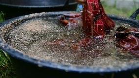Cotton being dyed manually in process of making Indonesian Batik stock video footage