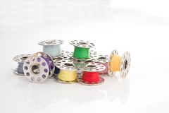 Cotton Bobbins. Colourful cotton reels isolated against a white background Stock Photography