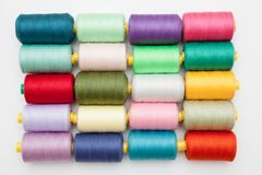 Cotton bobbins in a grid pattern. Royalty Free Stock Photos