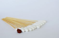 Cotton bud with iodine solution on white background. Cotton bud with iodine solution on the white background stock image