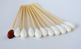 Cotton bud with iodine solution on white background. Cotton bud with iodine solution on the white background royalty free stock images